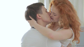 Red-haired angel passionately makes love with her man