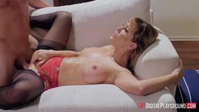 Busty mommy enjoying sweaty hardcore sex on a couch