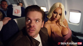 A busty young ebony girl has an airplane threesome